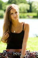 Lifestyle - Young woman sitting in park by PhilJonesPhotography