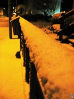 Snow-covered railing by wellgraphic