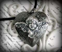 black cherub locket by JuleeMClark