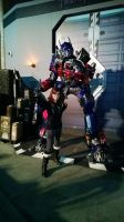 Posing with Optimus Prime by sonicshadowlover13