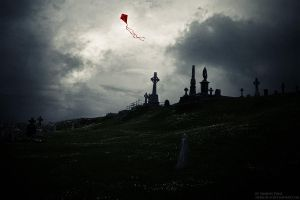 A kite above a graveyard by Sharon-N