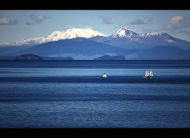 Lake Taupo And Mountains, NZ by JonGoldie