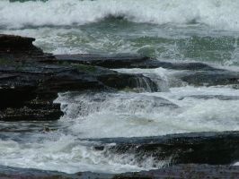 Waterfall Over beach Rocks by astrals-stock