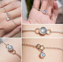 Grey-White Star Sapphire and Moonstone Bracelet by Sarahorsomeone