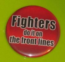 'Fighters do it on the front lines' button by BlackUnicornWood