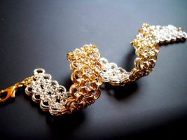 Gold and Silver Bracelet by Divulged