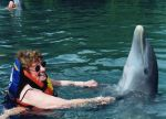 Mom and her dolphin friend by Sister-of-the-Moon