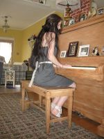 Piano player by 3corpses-in-A-casket