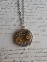 Steampunk necklace with small gears by SteamJo