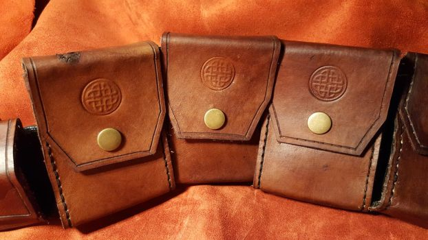 Hand sewn leather pouches  by PracticalApplication