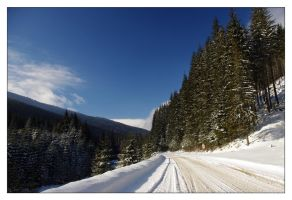 Snowy road by october27