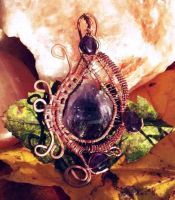 Wire-wrapped raw amethyst pendant by Catscendence