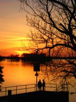 Two Figures and Setting Sun T by 8ankH