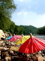 Parasols by the River by javakills