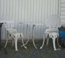 Old Outdoor White Chair and Table Stock by CNStock