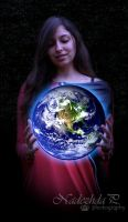 The world in my hands by nuffy00