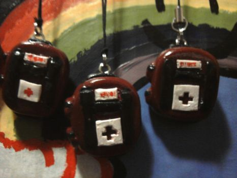 Med Kit Charms close up by Malice-Ghoststar